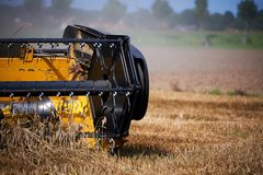 Harvester working on wheat field Royalty Free Stock Images