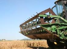 Harvesting. Combine Harvester picking soya bean crop, Australia Stock Photo