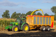 Harvesting agriculture tractor Royalty Free Stock Photography