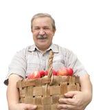 Harvesting a apple. Elderly man, harvesting a apple - isolated over white Stock Photo