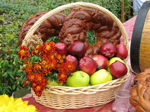 Harvesting apples, bread and flowers Stock Photos