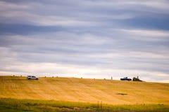 Harvesting bales of hay Royalty Free Stock Photos