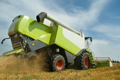 Harvesting combine in field Royalty Free Stock Photography