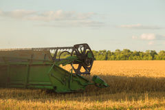 Harvesting combine in the field Stock Image