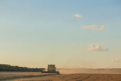 Harvesting combine in the field Royalty Free Stock Photo