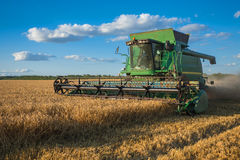Harvesting combine in the field Royalty Free Stock Photography
