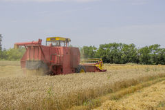 Harvesting combine in the field 2 Stock Photos