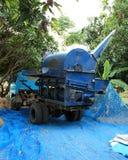 Harvesting combines. Combine machine harvesting. Harvesting combines. Blue combine machine harvesting Royalty Free Stock Image