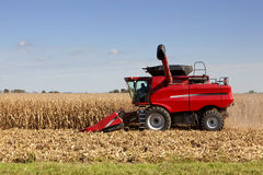 Harvesting corn. Tractors harvesting a crop of corn for feed and use in making ethanol additive for gas Royalty Free Stock Photo