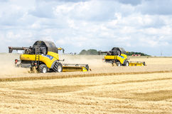 Combines harvesting field Royalty Free Stock Image