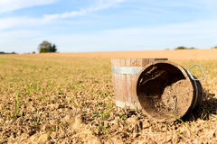 Harvesting a field the traditional way. Concept harvesting a field the traditional way Stock Image