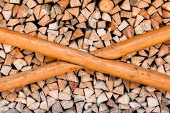Harvesting firewood for heating the house royalty free stock images