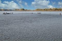 Harvesting Fish at Fish Farm. Commercial Fishing - Fishermen Pulling Fishing Net Royalty Free Stock Images