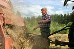 Harvesting hay baler, russian peasant repair Used Farm Machinery Stock Images