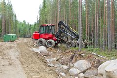 Harvesting machine near the forest path waiting before next work Royalty Free Stock Image