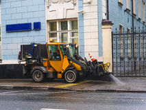 Harvesting machine washes the street Stock Images