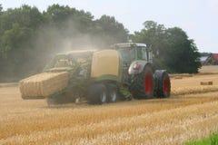 Harvesting - straw bale press Royalty Free Stock Photo