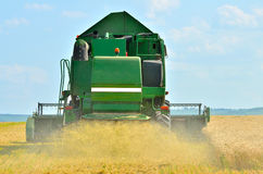 Combine harvester at work Royalty Free Stock Images