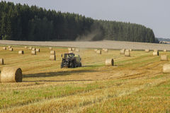 Harvesting of wheat straw. In late August, 2013 in Vogtland - Germany Royalty Free Stock Photo