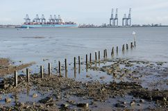 Distant view of Flexistowe from Harwich with beach in foreground. Harwich Essex United Kingdom -16 November 2017: Distant view of Flexistowe from Harwich with Royalty Free Stock Photography