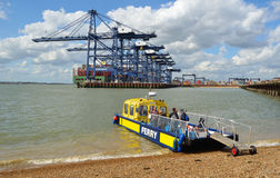Harwich to Felixstowe and Shotley ferry takes up to twelve people across the busy estuary, port of Felixstowe in background. Stock Photos