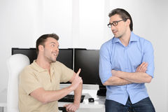 He has another point of view. Two young businessmen talking abou Stock Photography