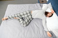 It has been a long night. mature male with beard in pajama on bed. asleep and awake. energy and tiredness. bearded man. Hipster sleep in morning. brutal sleepy royalty free stock photo