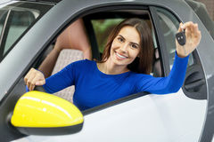 She has bought her dream car! Stock Photos