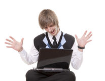 Has found the decision. The teenager sits with the computer has clutched at the head Stock Photos