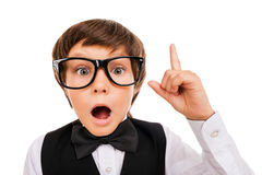 He has got an idea. Surprised young boy in bow tie and gesturing while isolated on white royalty free stock image