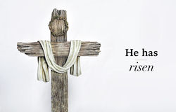 He has risen cross and words. Cross with he has risen words Royalty Free Stock Images