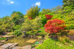 Hase-dera garden. Kamakura, Japan - April 23, 2017: small lake surrounded by a flowering garden in a sunny day at Hase-dera Temple or Hase-kannon, Kanagawa Stock Photography