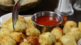 Hash brown potato bites and catsup stock footage