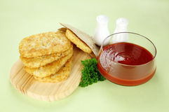 Hash Browns. With ketchup and parsley ready to serve royalty free stock photo