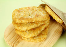 Hash Browns. Stack of fried hash browns on a board ready to serve royalty free stock images