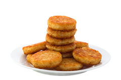 Hash browns. On white plate. Image is isolated on white background with clipping path stock photos