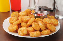 Hash browns. Hash brown potato cakes with catsup royalty free stock photography
