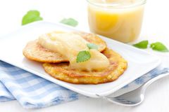 Hash browns and apple puree Royalty Free Stock Images