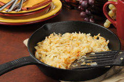 Hash browns in a cast iron skillet Stock Photo