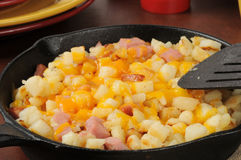 Hash browns with ham and cheese Stock Images