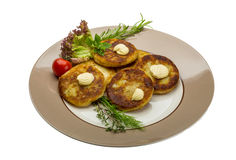 Hash browns. With herbs on the plate royalty free stock photos