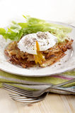 Hash browns with poached egg Stock Photography