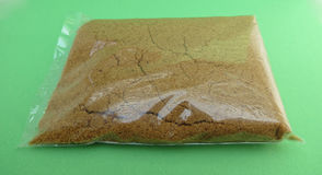 Hashish or brown sugar Royalty Free Stock Photography