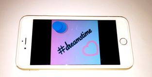 Hashtag Dreamstime. An artsy photo of a phone that says hashtag dreamstime royalty free stock photo