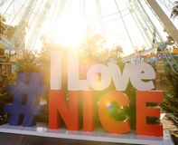 Hashtag I Love Nice sign on place Massena square in Nice. Travel and tourism royalty free stock images