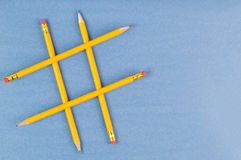 Hashtag. Made with yellow pencils on a blue background Stock Photos