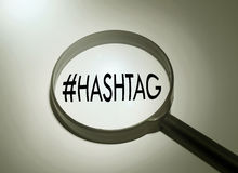 Hashtag. Magnifying glass with the word hashtag. Searching hashtag Royalty Free Stock Photography