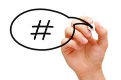 Hashtag Speech Bubble Concept. Hand sketching Hashtag Speech Bubble Concept with black marker on transparent wipe board Stock Photos