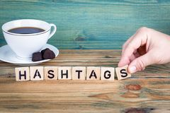 Hashtags. Wooden letters on the office desk, informative and communication background.  royalty free stock images