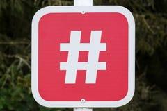 Hashtaguithangbord en fotografisch punt stock foto